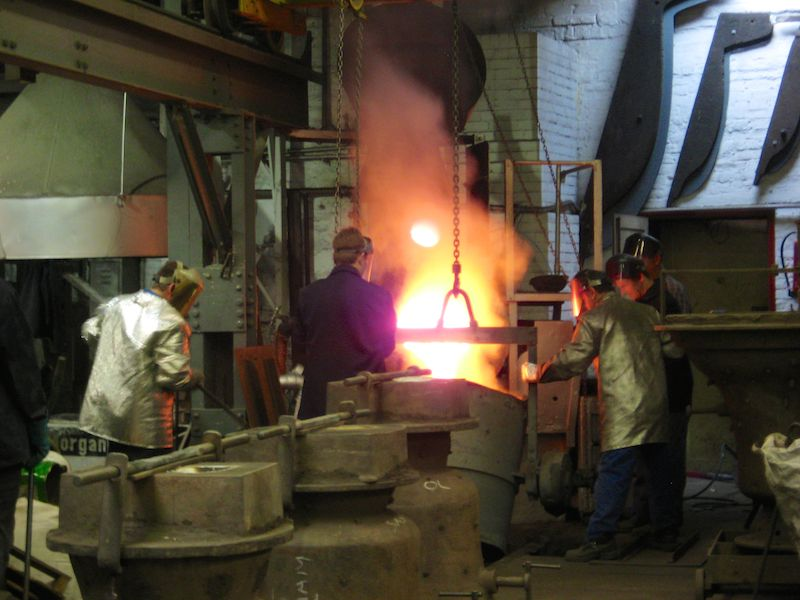 Pouring molten metal from the furnace into the ladle