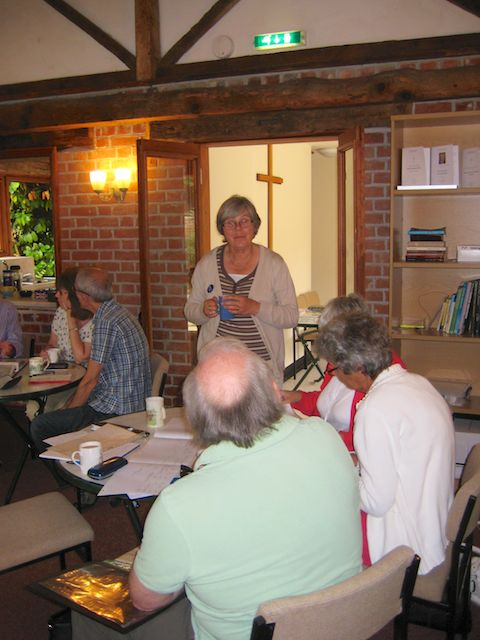 Corinne discussing internet resources with attendees.
