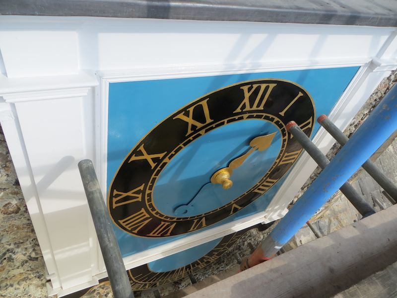 Clock face being re-installed